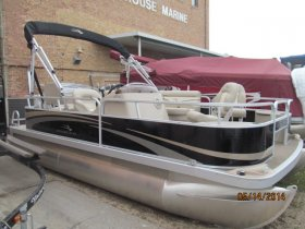18 foot fishing pontoon, two seats forward and two fishing seats in the rear, lounges in between.